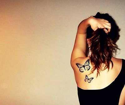 tatuagens costas animais borboletas